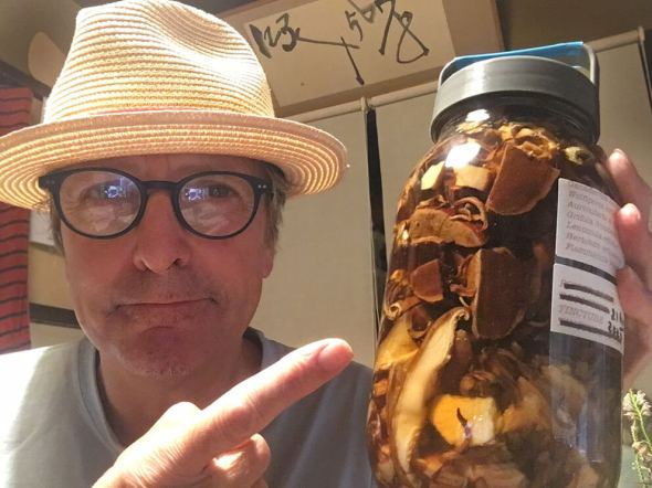 Man holding mushroom jar